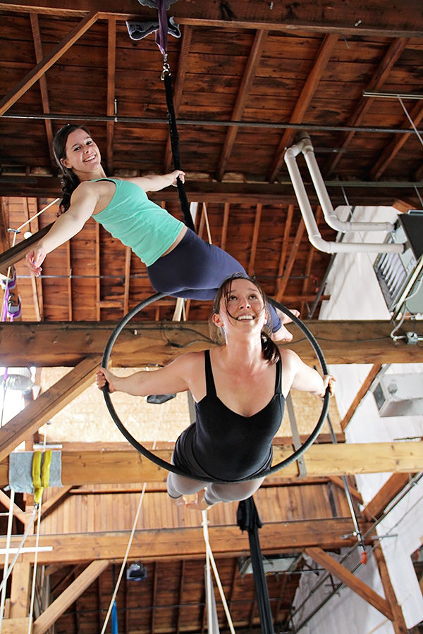 Girls doing Aerial Hoop at Emerald City Trapeze
