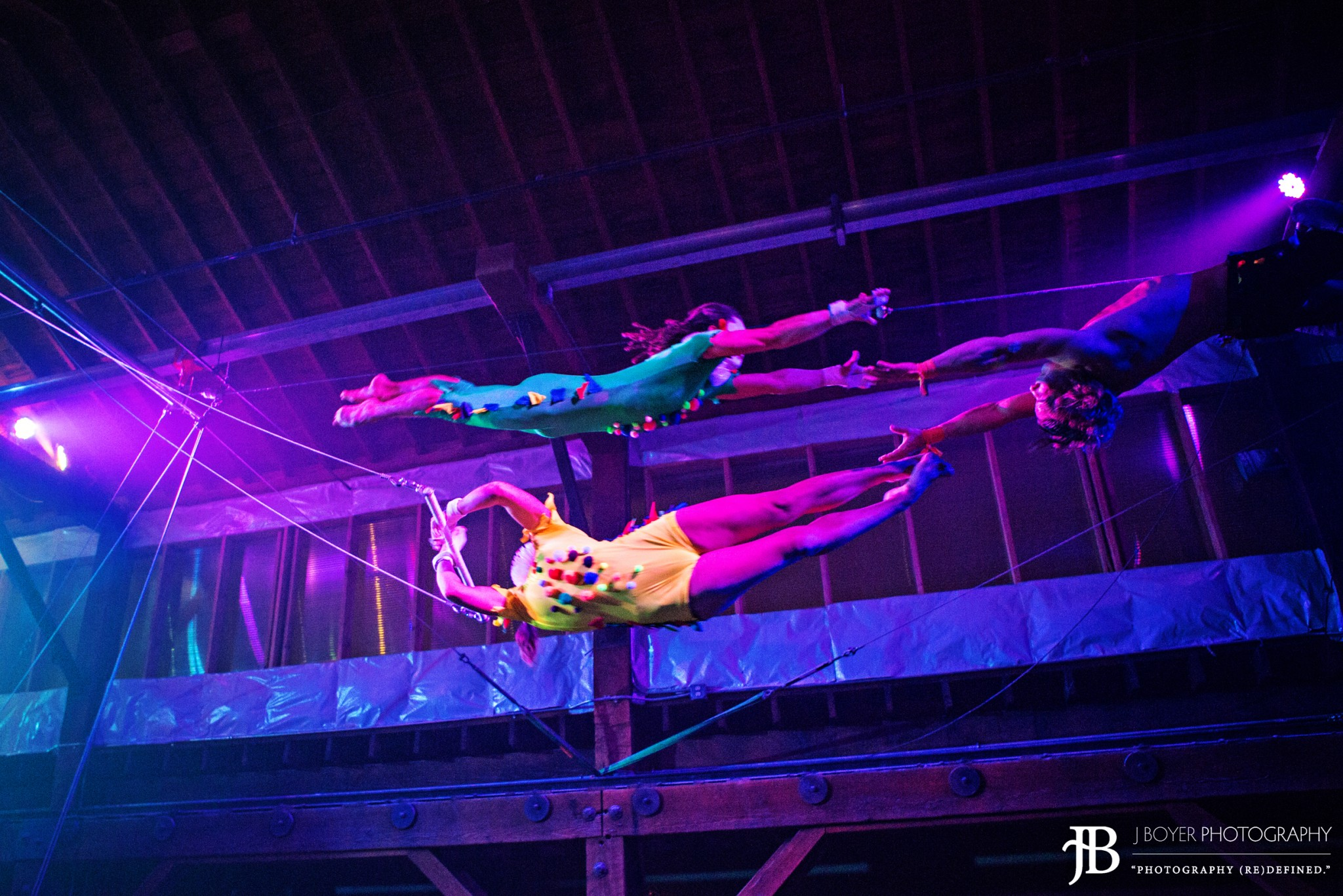 flying trapeze at emerald city trapeze carnevolar halloween show