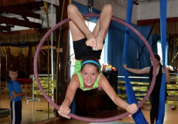 Girl Doing Aerial Hoop at Emerald City Trapeze Arts in Seattle