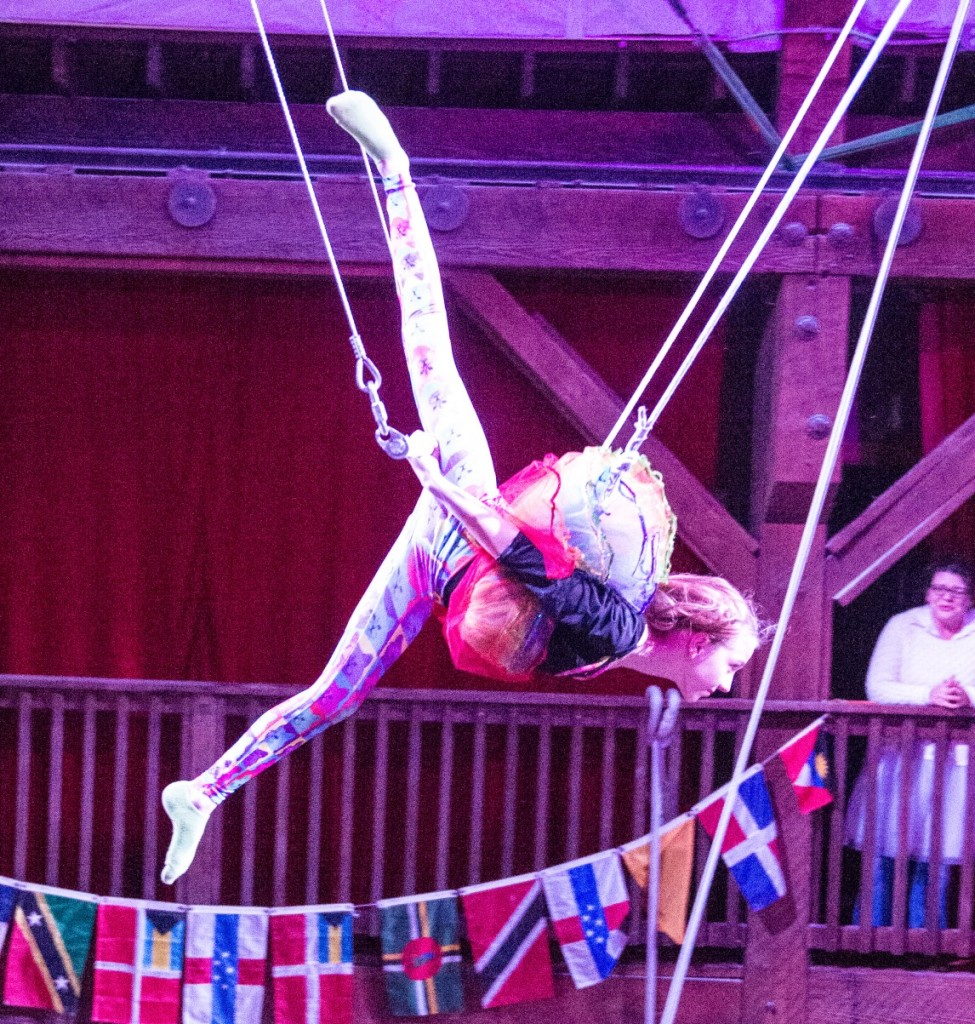 Girl doing Flying Trapeze at Emerald City Trapeze in Seattle