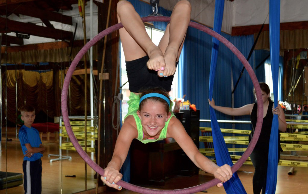 Girl doing aerial hoop during summer camp at Emerald City Trapeze