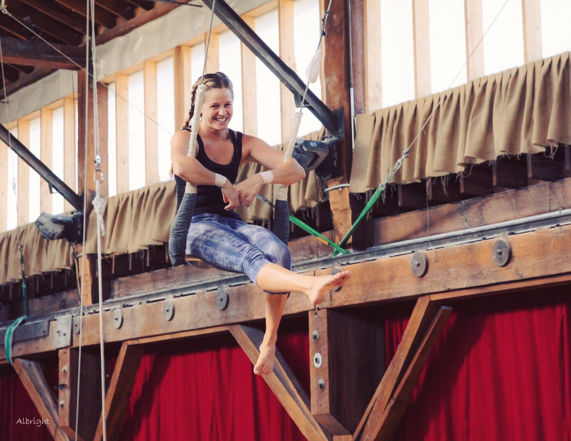 Little girl on Flying Trapeze in Seattle - Emerald City Trapeze Arts